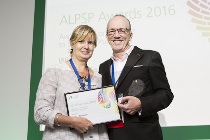Photo of Alice Meadows receiving Award from Peter Ashman